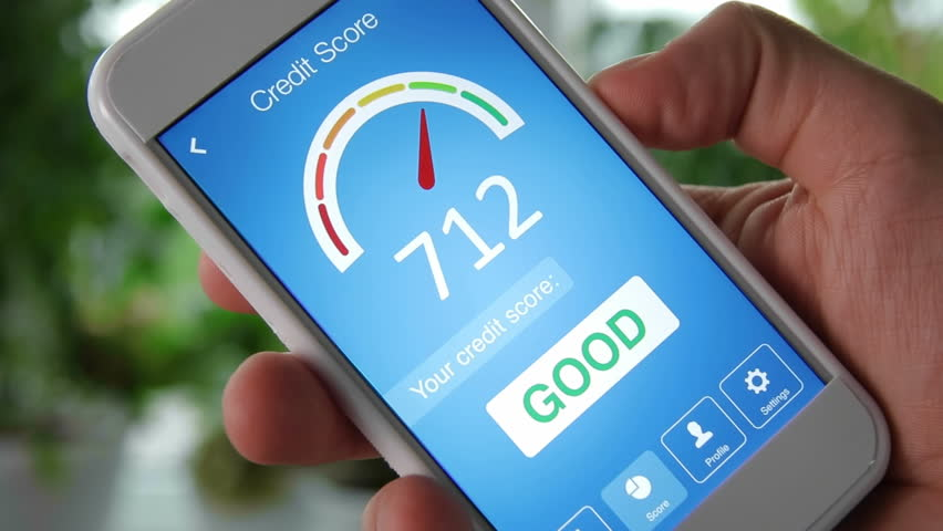Checking credit score on smartphone using application. The result is GOOD