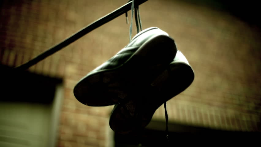 Shoes on a powerline, often a sign of a place to buy drugs