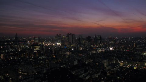 Japan Tokyo Aerial v73 Flying low over Shinjuku area panning with cityscape views at night