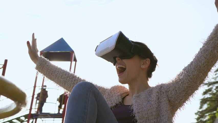 Woman having fun with virtual reality glasses Spin around 360