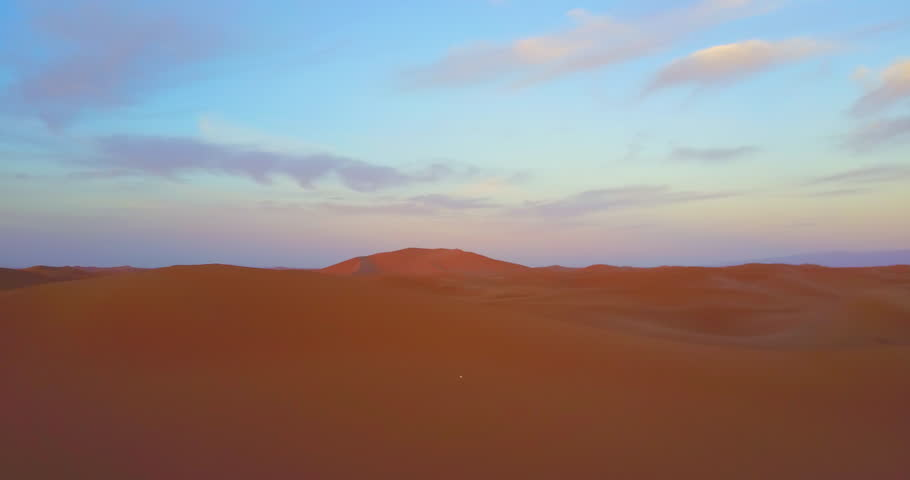 Morocco-2010s: A remarkable aerial over desert sand dunes at sunrise in Morocco. | Shutterstock HD Video #28631311