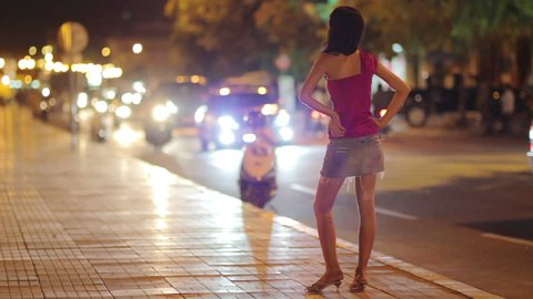 a whore waiting for a customer on street  in the evening