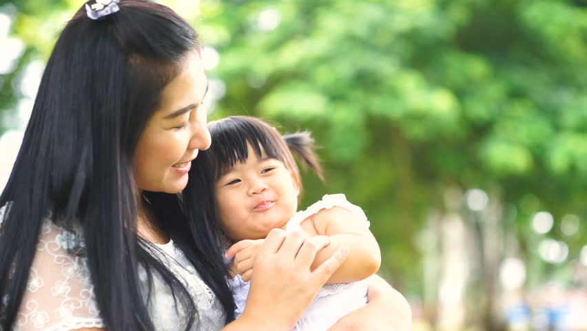 Asian Mother and Baby having fun Outdoors.Together in Green Summer Park. Mom and Child. Happy Family Smiling. Beautiful family in spring park enjoying nature.slow motion | Shutterstock HD Video #28645765