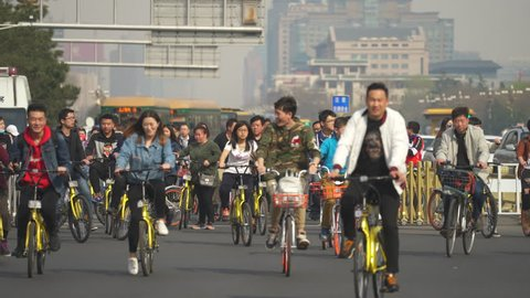 Crowd of cyclist in Beijing. Chaotic, crowded street scene - March 2017: Beijing Tiananmen, China
