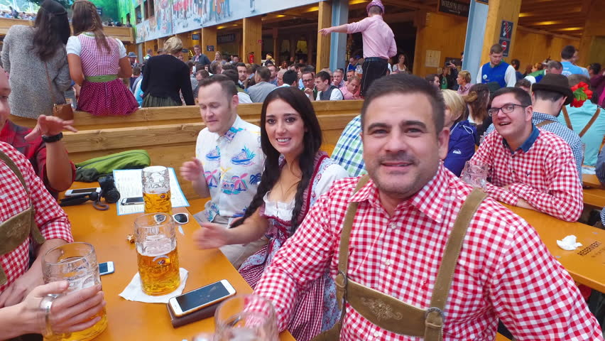 Munich, Germany-2010s: People drink, sing and celebrate at Oktoberfest, Germany.