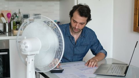 The video is about a sweaty man refreshing himself in front of a fan because of summer heat