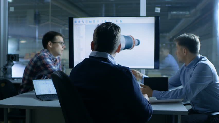 Team of Industrial Engineers Discuss 3D Turbine/ Engine Part Design Shown on a Presentation Display. In the Background Factory is Seen. Shot on RED EPIC-W 8K Helium Cinema Camera. | Shutterstock HD Video #28698274