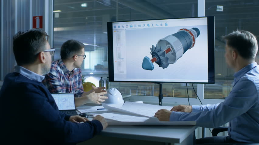 Team of Industrial Engineers Discuss 3D Model of Turbine/ Engine Design Shown on a Presentation Display. In the Background Factory is Seen. Shot on RED EPIC-W 8K Helium Cinema Camera. | Shutterstock HD Video #28698424