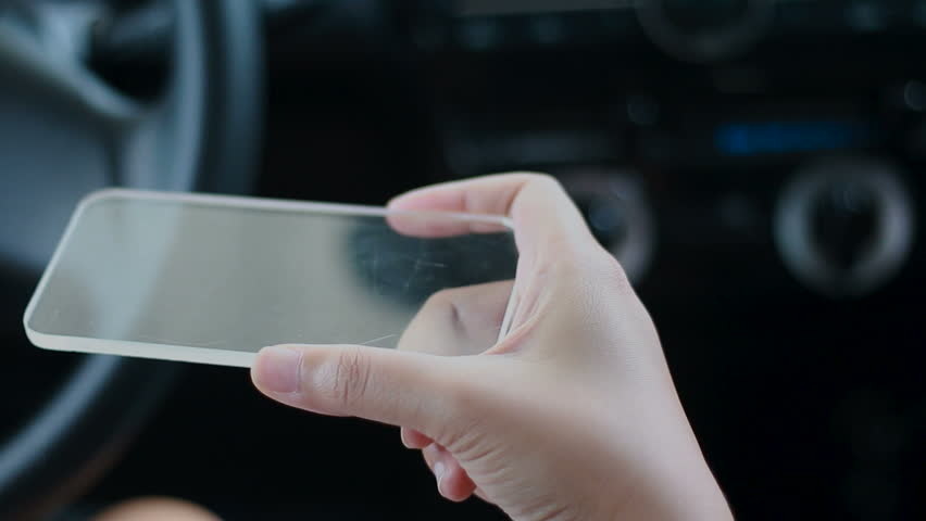 Close up shot hands of woman using clear glass smart phone in the car for futuristic cyber technology concept | Shutterstock HD Video #28721464