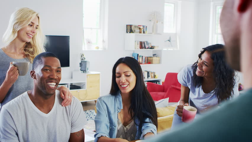 Group Of Young Friends Chatting And Drinking Coffee In Kitchen | Shutterstock HD Video #28732024
