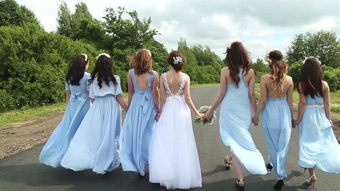 Bride and bridesmaids are on the road