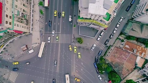 Aerial view of cars driving in Bucharest, Romania towards the Roman Square