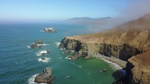 Remnants of morning mist sweeps along the beautiful coast of northern California in Sonoma. This scenic part of California has many trails and beaches accessible from the Pacific Coast Highway.
