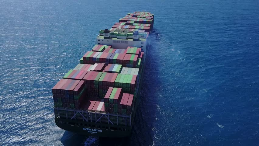 Haifa, Israel - 14 Jul, 2017: The large EVER LOTUS container ships is leaving the port full loaded wit containers and cargo - aerial 4k view #28779004