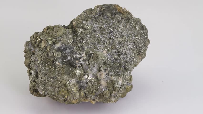 Pyrite or fool's gold, mineral stone isolated on a white background