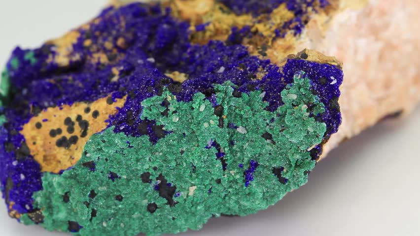 Azurite Malachite, green and blue mineral stone isolated on a white background