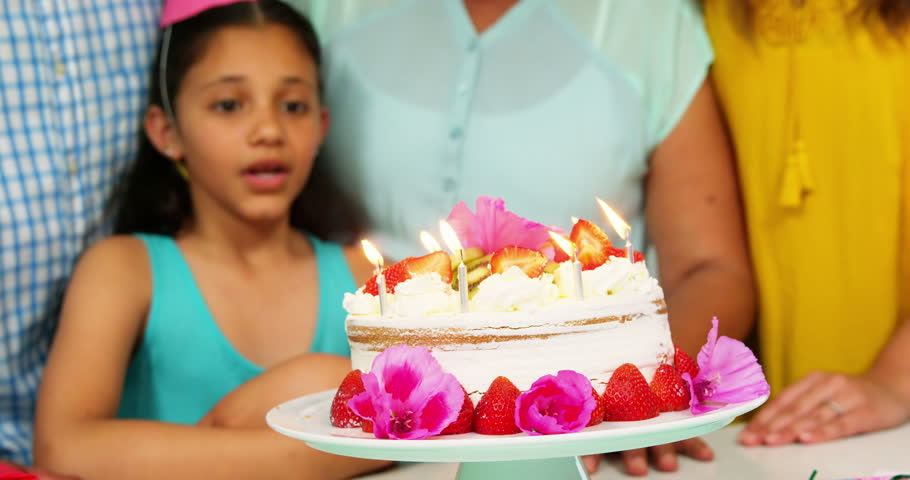 Grandmother Blowing Out Birthday Candles Stock Footage Video