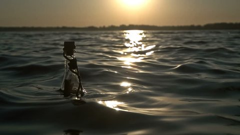 A bottle with a note swings on the waves