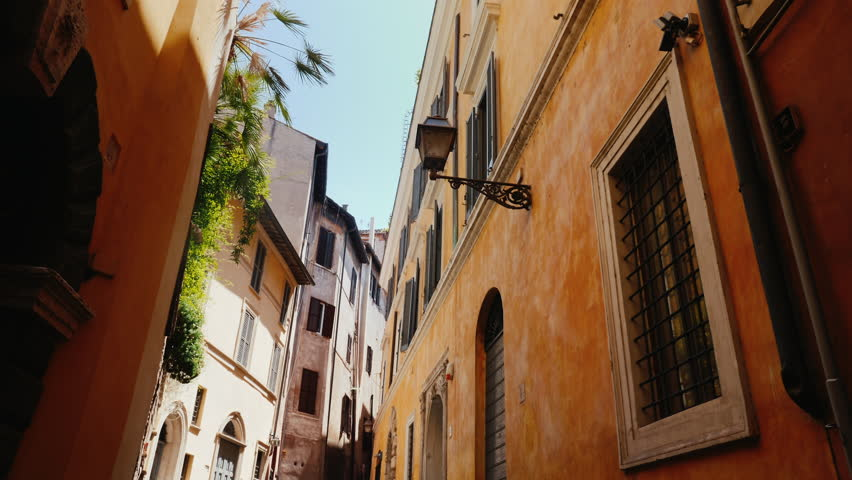 Beautiful narrow street in the old part of Rome, Italy. Medieval buildings covered with ivy. Steadicam shot | Shutterstock HD Video #28894624
