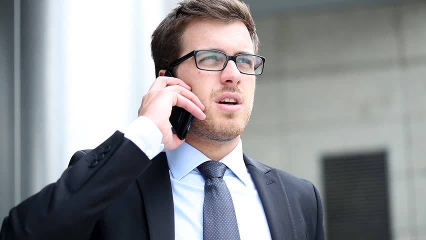 Handsome businessman talking at phone