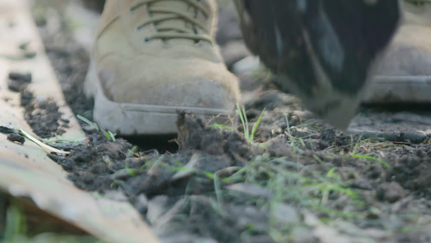 Soldier digging hole in the dirt