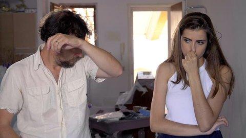 Woman telling boyfriend that he stinks slow motion