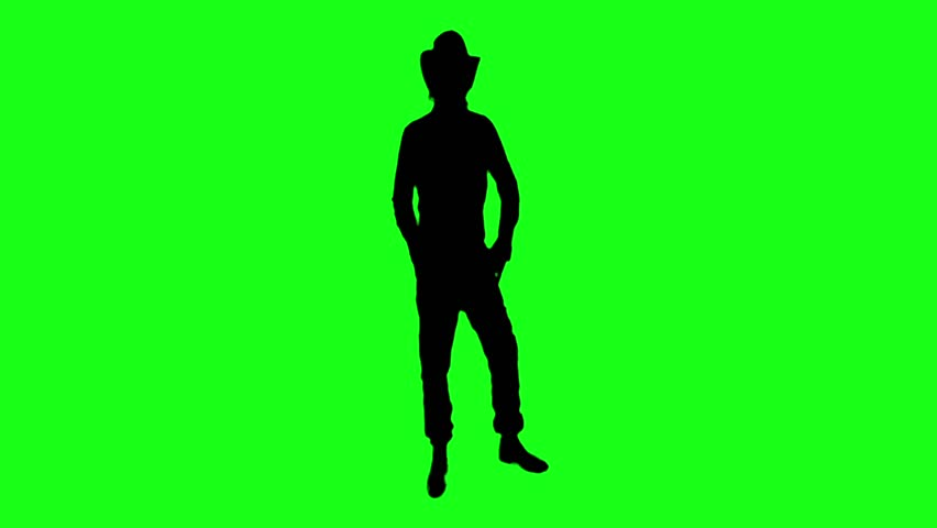 Cool cowboy in the hat is dancing funny on the Green Screen. Miniature: the actor comedian is moving and dancing with accelerated motion.