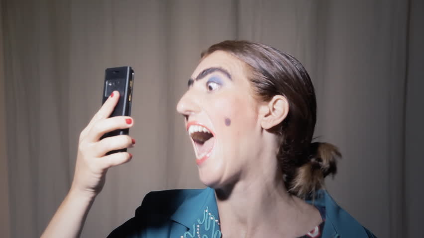A funny ugly woman (an actor in character) making a series of selfies with a smartphone. Grotesque comedy scene.  | Shutterstock HD Video #29012194