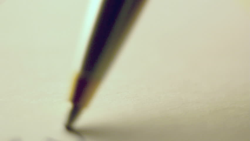 Pen signing a document close up, shot with shallow depth of field