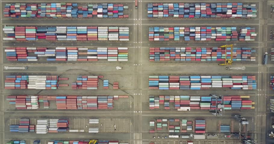 JAKARTA, Indonesia. July 10, 2017: Top view footage of containers terminal with cranes and truck in Tanjung Priok industrial port. Shot in 4k resolution | Shutterstock HD Video #29074354