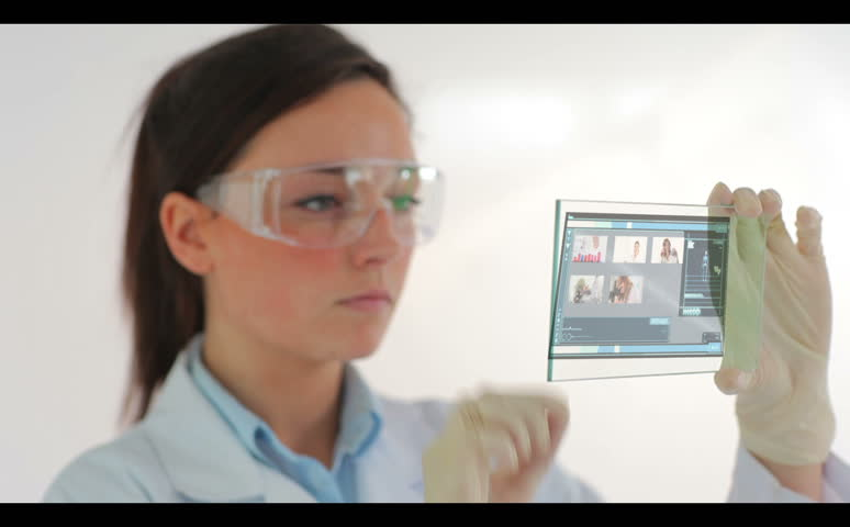 Scientist wearing protective clothes and watching holographic videos of research