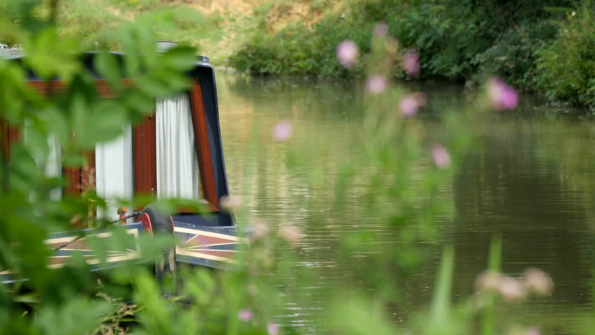 Narrowboat moored on Kennet and Avon Canal, Wiltshire, UK