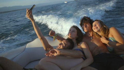 Young adult friends on a boat