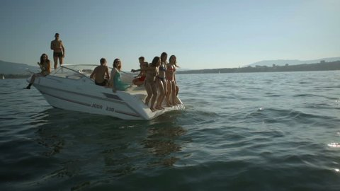 Young adult friends boat session