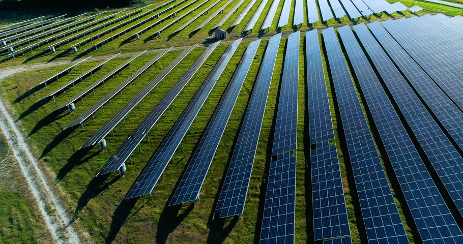 Solar panel farm seen from above, filmed by drone in france
