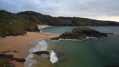 Murder Hole - Ireland's most mysterious secret beach in Donegal/ Murder Hole beach/ Amazing view on Murder Hole beach and small island in Donegal, Ireland.