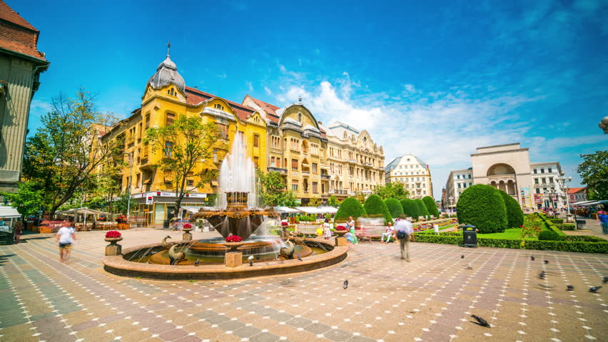 Timisoara, Romania - July 8, 2016: Timisoara Timelapse view showing historical district with fountain by day