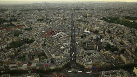 Luxembourg Palace and Saint-Sulpice church distant view from panoramic terrace of Tour Montparnasse in Paris skyline. French capital in Europe on Rue Rennes street. time lapse.