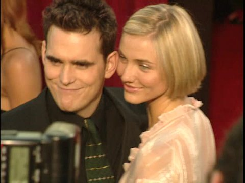 Los Angeles, CA - MARCH 23, 1998: Matt Dillon, Cameron Diaz, walks the red carpet at the Academy Awards 1998 held at the Shrine Auditorium