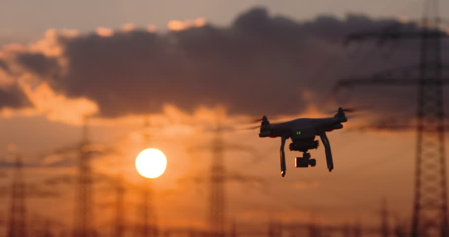 Drone flying in front of a sunset. 4K Video footage | Shutterstock HD Video #29276494