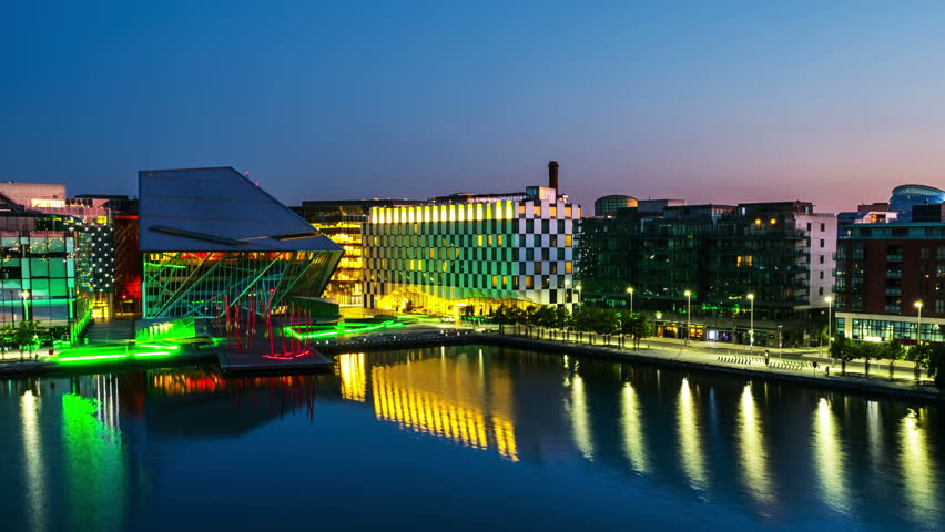 Dublin, Ireland. Aerial view of Grand Canal docks in Dublin, Ireland at sunrise. Empty streets and illuminated modern buildings, colorful clear sky. Time-lapse from night to day. Zoom in | Shutterstock HD Video #29300434