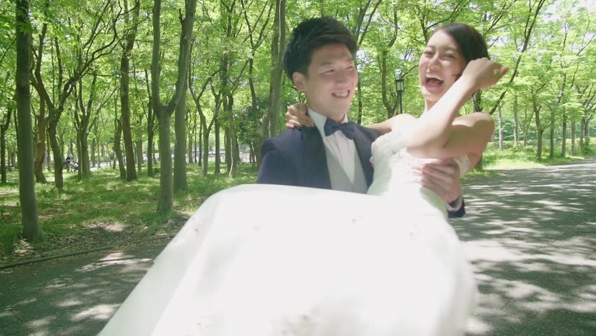 Japanese groom spinning beautiful new bride stylized color grade   HD stock  video clip. Blonde Woman Relaxing In An Open Bath With Foam  Skin Care