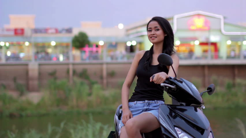 Sexy Asian Girl With Mini Skirt Next To Motorcycle Stock Footage Video 2931955 -7905