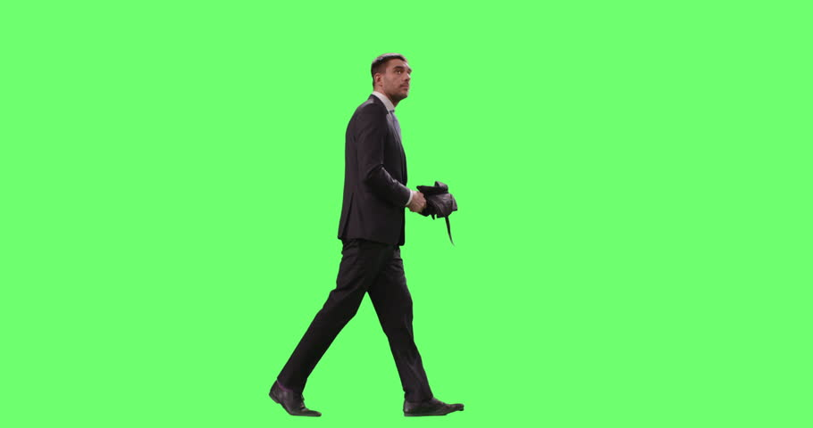 Businessman in a Suit Opens Umbrella While Walking. Shot on Mock-up Green Screen. Shot on RED Cinema Camera in 4K (UHD).