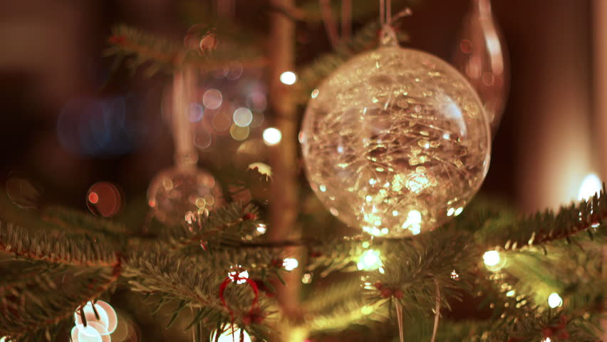 Decorations On Christmas Tree Vertical Tracking Shot With Pull Focus To Baubles And Lights Shallow Give Beautiful Bokeh