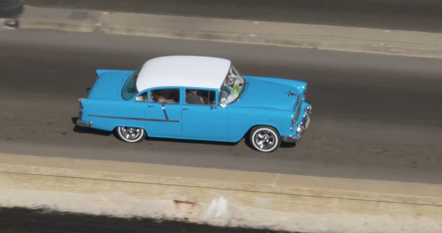 A high angle aerial view of colorful classic cars traveling on the streets of Havana, Cuba.  	 #29378224