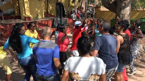 TRINIDAD, CUBA - FEBRUARY 2017: Local Cubans salsa dance at a party in Trinidad