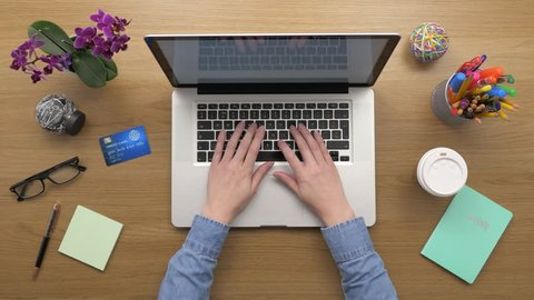 Overhead Top View Of woman Using Laptop And Credit Card