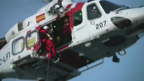 ALICANTE COAST, SPAIN - OCTOBER 24: The helicopter of the Spanish  Maritime Rescue Team and his rescuers, take and wounded from a Spanish Navy boat, on october 24, 2012 in Alicante coast.