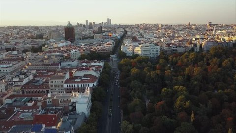 Fly over the evening Madrid with a view of the house and the road